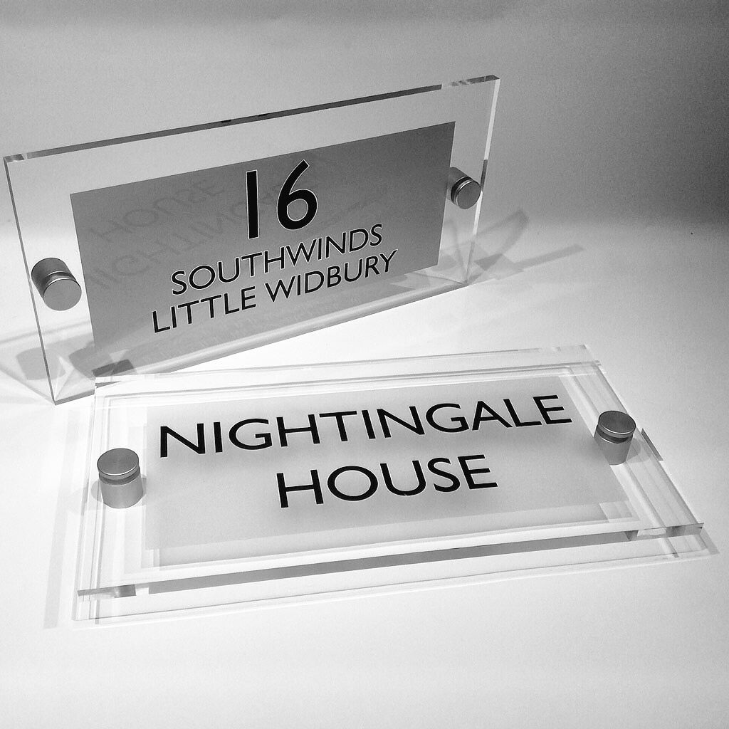 Clear acrylic plastic sheet used to create a house sign